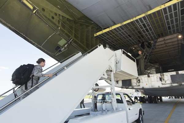 U.S. Air Force medical personnel board a military aircraft