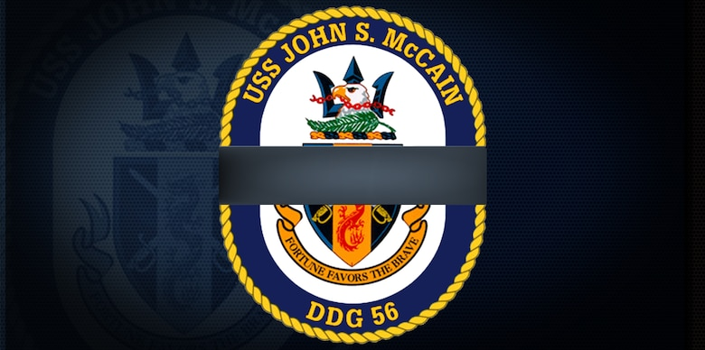 The crest of the guided-missile destroyer USS John S. McCain (DDG 56) modified with the traditional black ribbon signifying remembrance or mourning.