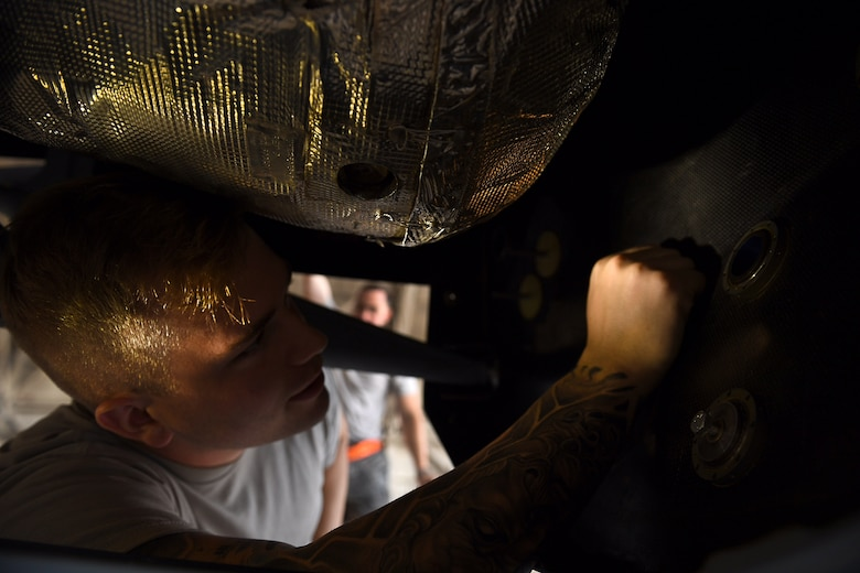 Airman 1st Class Conner, crew chief assigned to the 432nd Maintenance Group, inspects the inside of an MQ-9 Reaper model fuselage August 24, 2017, at Dover Air Force Base, Del.