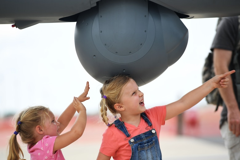 Children touch the Multi-Spectral Targeting System of an MQ-9 Reaper at the Thunder Over Dover Open House, Aug. 25, 2017, at Dover Air Force Base, Del.
