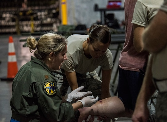 A medic from the 59th Medical Wing, Joint Base San Antonio-Lackland, Texas, assists a patient at the George Bush Intercontinental Airport in Houston, Texas, in response to the devastation caused by Hurricane Harvey, August 30, 2017. The 59th MDW is part of a larger Department of Defense presence in an effort to aid eastern Texas following a record amount of rainfall and flooding. (U.S. Air Force photo/Senior Airman Stefan Alvarez)