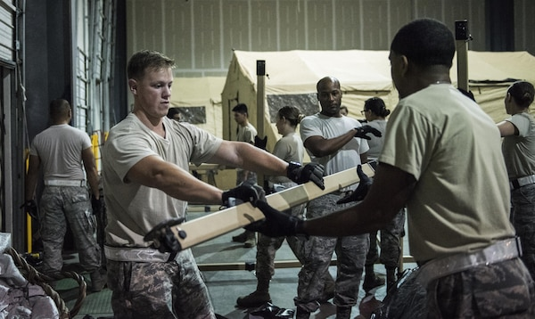 Personnel from the 59th Medical Wing, Joint Base San Antonio-Lackland, Texas, prepare their equipment to accept patients at the George Bush Intercontinental Airport in Houston, Texas, in response to the devastation caused by Hurricane Harvey, August 30, 2017. The 59th MDW is part of a larger Department of Defense presence in an effort to aid eastern Texas following a record amount of rainfall and flooding. (U.S. Air Force photo/Senior Airman Stefan Alvarez)