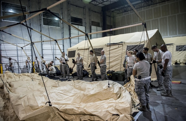 Personnel from the 59th Medical Wing, Joint Base San Antonio-Lackland, Texas, set up a medical tent inside a hangar at the George Bush Intercontinental Airport in Houston, Texas, during relief efforts following the devastation caused by Hurricane Harvey, August 30, 2017. The 59th MDW is part of a larger Department of Defense presence in an effort to aid eastern Texas following a record amount of rainfall and flooding. (U.S. Air Force photo/Senior Airman Keifer Bowes)