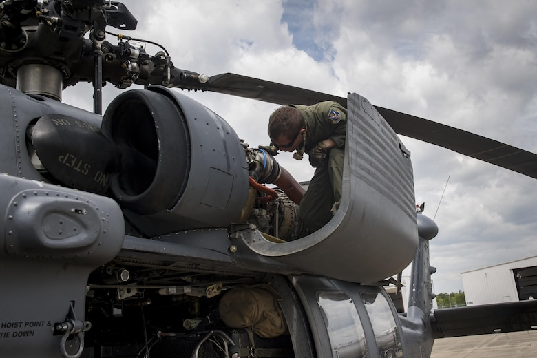 A special missions aviator from the 41st Rescue Squadron, inspects an engine on an HH-60G Pave Hawk, Aug. 30, 2017, at Easterwood Airport in College Station, Texas.