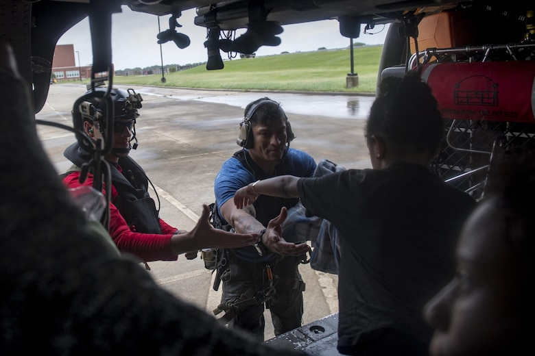 Pararescuemen from the 38th Rescue Squadron unload evacuees from an HH-60G Pave Hawk, Aug. 30, 2017, in the Houston, Texas area.