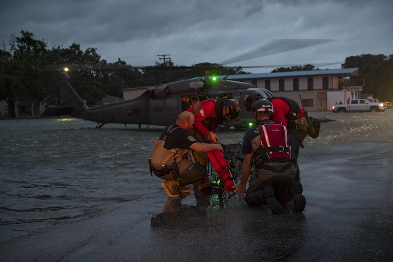 Pararescuemen from the 38th Rescue Squadron and local rescue assets, set up a basket to carry an evacuee, Aug. 30, 2017, in the Houston, Texas area.
