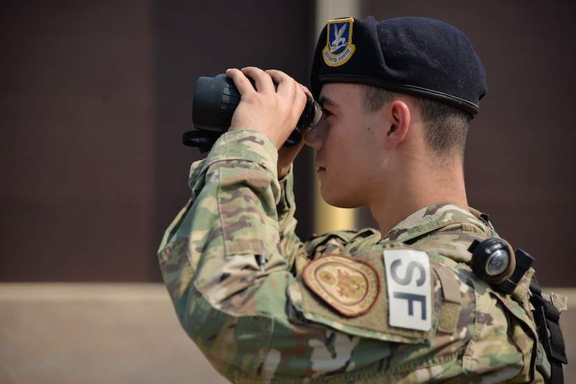 Airman 1st Class Dillan Caceres, 341st Missile Security Forces Squadron response force leader, performs a random antiterrorism measure at a missile alert facility Aug. 28, 2017, near Belt, Mont.