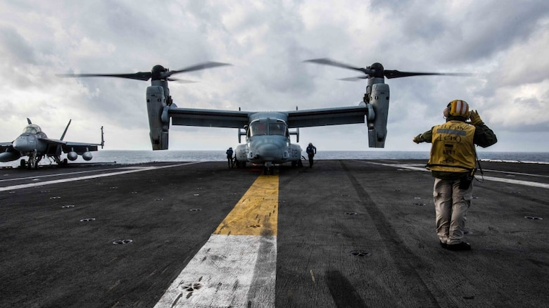 An MV-22 Osprey of Marine Medium Tiltrotor Squadron 265 lands on the flight deck of the Navy's forward-deployed aircraft carrier, USS Ronald Reagan.