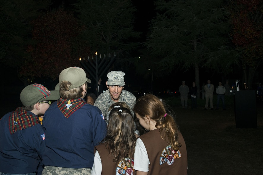 U.S. Air Force Col. Daniel Lasica, 20th Fighter Wing commander, flips a switch with members of Cub Scout Troop 320 and Girl Scout Troop 1829 during a Holiday Display Lighting event in front of the Friendship Chapel at Shaw Air Force Base, South Carolina, Nov. 29, 2017.
