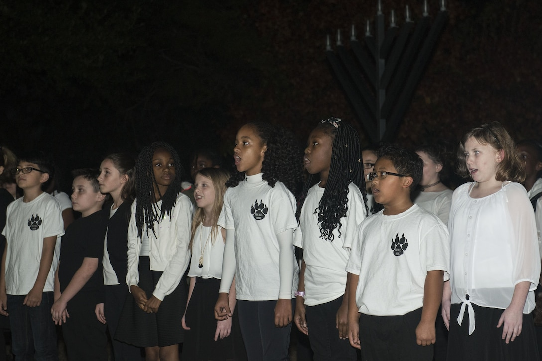 Students from High Hills Elementary School sing holiday songs during a Holiday Display Lighting event in front of the Friendship Chapel at Shaw Air Force Base, South Carolina, Nov. 29, 2017.