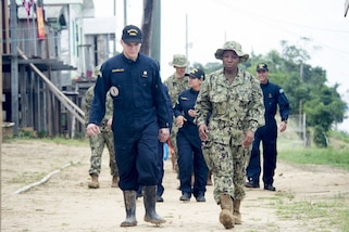 Medical personnel talk while walking.
