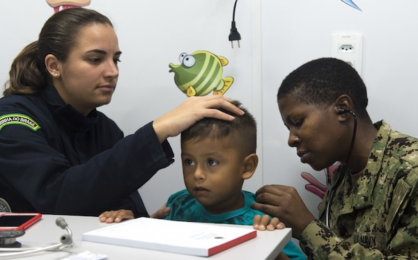 Doctors treat a child patient in Brazil.