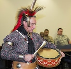 Retired U.S. Navy Master Chief and USCENTCOM civilian employee, Timothy Vickers performs a song during a presentation of Kiowa culture at U.S. Central Command headquarters. Vickers' Kiowa tribal heritage stems from the line of Chief Satanta (White Bear), one of the best known, and last, of the Kiowa war chiefs. USCENTCOM celebrates National American Indian Heritage Month every November to  recognize the contributions made by American Indian and Alaska Native people.