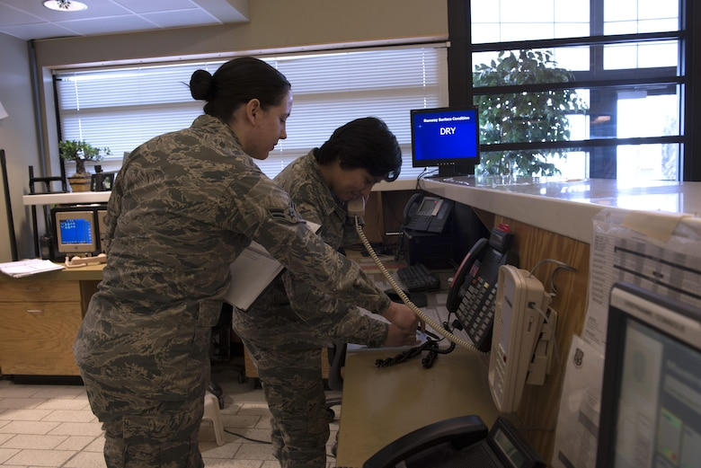 From Left to Right, Airman 1st Class Sabrina Watson and Maritza Rivera, 366th Operations Support Squadron airfield management coordinators, practice an exercise training situation Nov. 30, 2017, at Mountain Home Air Force Base, Idaho. The airfield management team's main priority is safety for crewmembers and aircraft. (U.S. Air Force photo by Senior Airman Lauren-Taylor Levin)