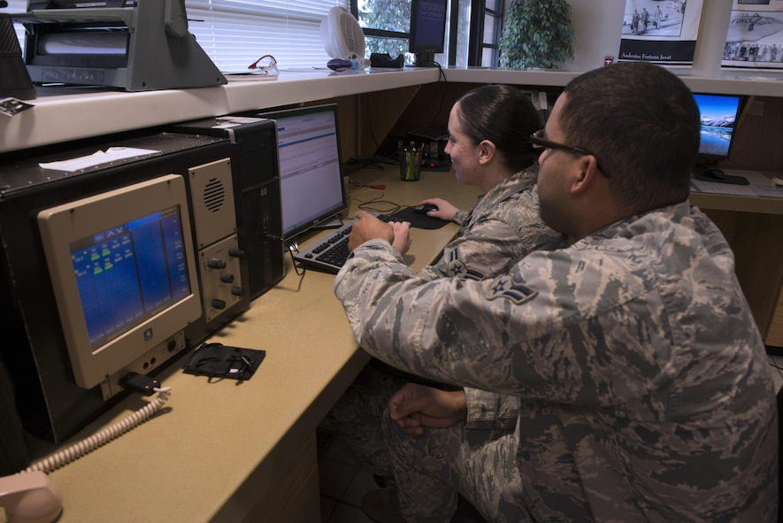 From Left to Right, Airman 1st Class Douglas Whitter and Sabrina Watson, 366th Operations Support Squadron airfield management coordinators, fill out flight plans for pilots at Mountain Home Air Force Base, Idaho, on Nov. 29, 2017. The airfield management team has to complete and submit their flight plans for approval prior to pilots taking off. (U.S. Air Force photo by Senior Airman Lauren-Taylor Levin)