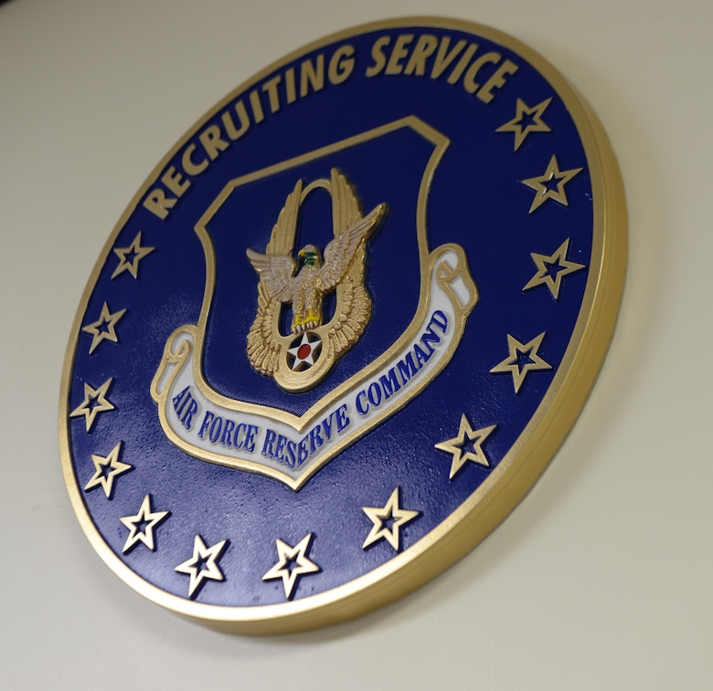 The logo for the U.S. Air Force Reserves command sits in the office of U.S. Air Force Master Sgt. Brandy Venson, an in-service recruiter assigned to the 97th Air Mobility Wing, November 20, 2017, Altus Air Force base, Okla.