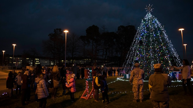 Members of the Kaiserslautern Military Community and Ramstein-Miesenbach gather for the lighting of the base Christmas tree at Ramstein Air Base, Germany, Nov. 29, 2017. The tree represents the ever growing relationship between the KMC and the local Ramstein-Miesenbach community. (U.S. Air Force photo by Airman 1st Class Devin M. Rumbaugh)