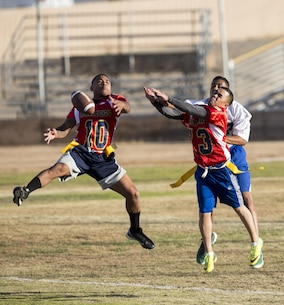 Sgt. Xzavier Wolef (left) and Staff Sgt. Pedro Villa knock down a pass attempt during the first half of thi year's Turkey Bowl, pitting MCLB Barstow Marines against Marine reservist assigned to Fleet Support Division Nov. 21 aboard Marine Corps Logistics Base Barstow.