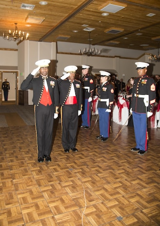 Lieutenant General Ronald Bailey, USMC Retired, and Colonel Sekou Karega, commading officer, Marine Corps Logistics Base Barstow, salute the American Flag and Marine Corps Colors during the 242nd Marine Corps Birthday Ball held at Big Bear Lodge, Big Bear, Calif., Nov. 18.