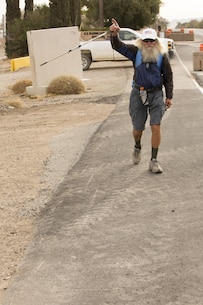 Sunny Eberhart completes his traversing of Marine Corps Logistics Base Barstow, Calif., Nov. 15 as another part of his mission to walk the entirety of Route 66 from Chicago to Santa Monica, Calif., a distance of 2,400 miles. Joseph Boll Avenue through the base is part of the iconic Mother Road.