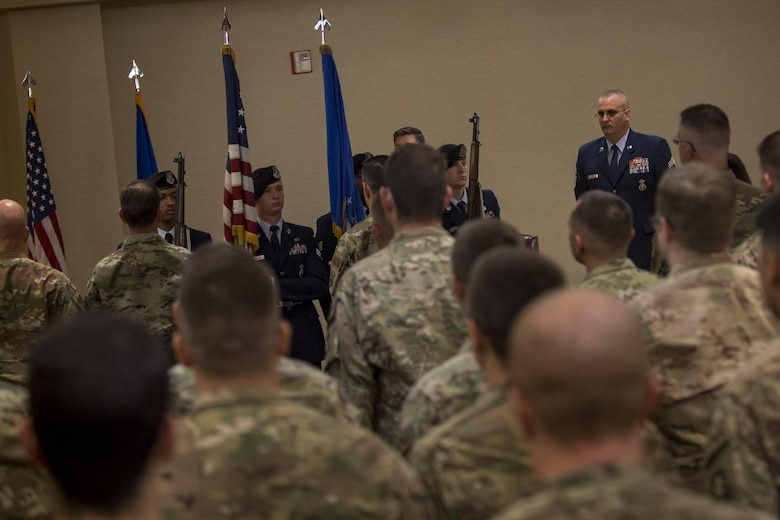 Airmen from the 820th Base Defense Group stand at attention during the presentation of the colors at a retirement ceremony for Chief Master Sgt. David Houtz, 823d Base Defense Squadron chief enlisted manager, Dec. 1, 2017, at Moody Air Force Base, Ga. Houtz enlisted in the Air Force on Oct. 6, 1991. During his 27-year career, he has held numerous leadership roles while supporting Operations Provide Promise, Southern Watch, Enduring Freedom, Iraqi Freedom and Inherent Resolve. (U.S. Air Force photo by Senior Airman Daniel Snider)