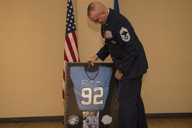 Chief Master Sgt. David Houtz, 823d Base Defense Squadron chief enlisted manager, opens a gift during his retirement ceremony, Dec. 1, 2017, at Moody Air Force Base, Ga. Houtz enlisted in the Air Force on Oct. 6, 1991. During his 27-year career, he has held numerous leadership roles while supporting Operations Provide Promise, Southern Watch, Enduring Freedom, Iraqi Freedom and Inherent Resolve. (U.S. Air Force photo by Senior Airman Daniel Snider)