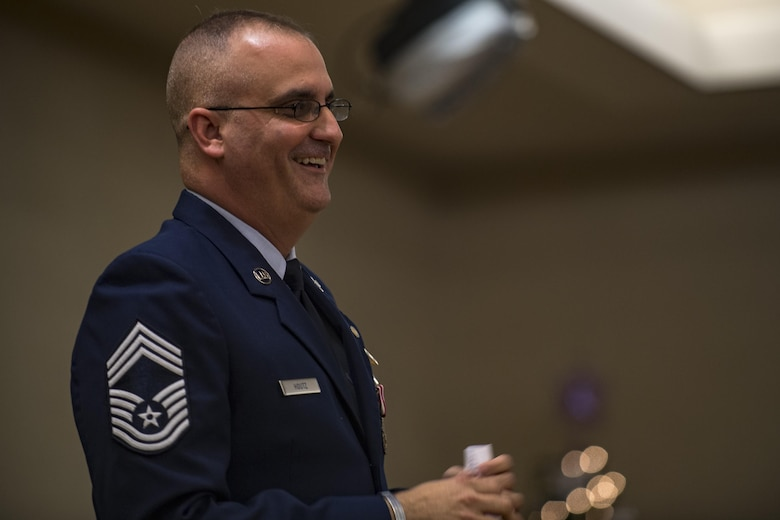 Chief Master Sgt. David Houtz, 823d Base Defense Squadron chief enlisted manager, laughs while giving remarks during his retirement ceremony, Dec. 1, 2017, at Moody Air Force Base, Ga. Houtz enlisted in the Air Force on Oct. 6, 1991. During his 27-year career, he has held numerous leadership roles while supporting Operations Provide Promise, Southern Watch, Enduring Freedom, Iraqi Freedom and Inherent Resolve. (U.S. Air Force photo by Senior Airman Daniel Snider)