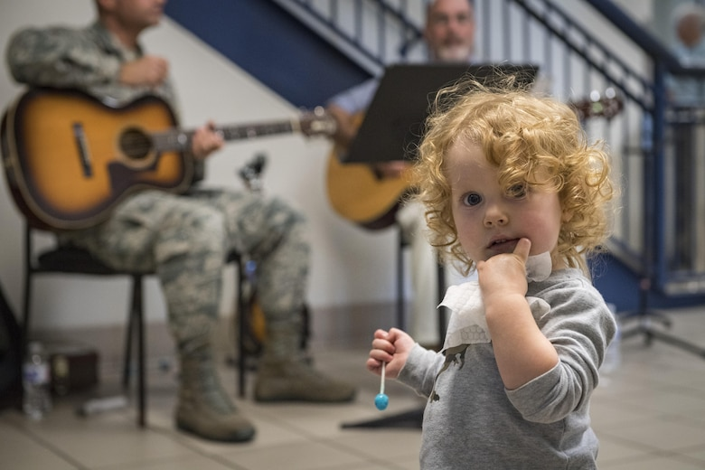 Charlotte Molnar, daughter of Master Sgt. William Molnar, 23d Wing Command Post superintendent, poses for a photo during the Airmen and Family Readiness Center's (AFRC) 'grand reopening', Nov. 29, 2017, at Moody Air Force Base, Ga. The AFRC relocated to the Freedom 1 Fitness Center, but held the event as the grand finale to their month of the military family campaign and to showcase their new location to Moody. (U.S. Air Force photo by Senior Airman Janiqua P. Robinson)