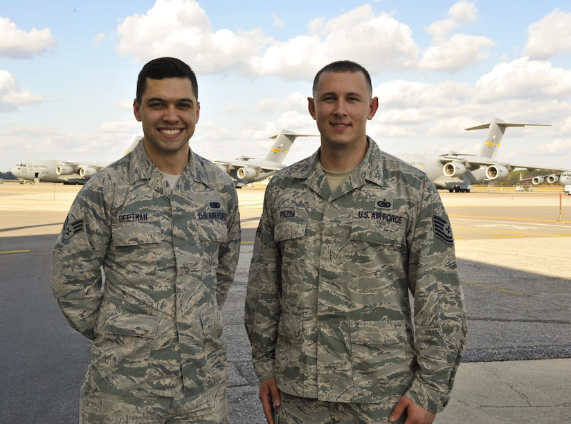 Senior Airman Ryan Deetman, left, 628th Logistics Readiness Squadron central storage journeyman, poses with Tech. Sgt. Dominic Piazza, 628th LRS central storage supervisor in front of the flightline at Joint Base Charleston, S.C., Nov. 30, 2017.