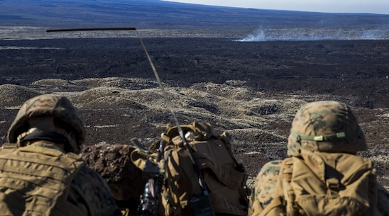 U.S. Marines with 2nd Battalion, 3rd Marines call for fire