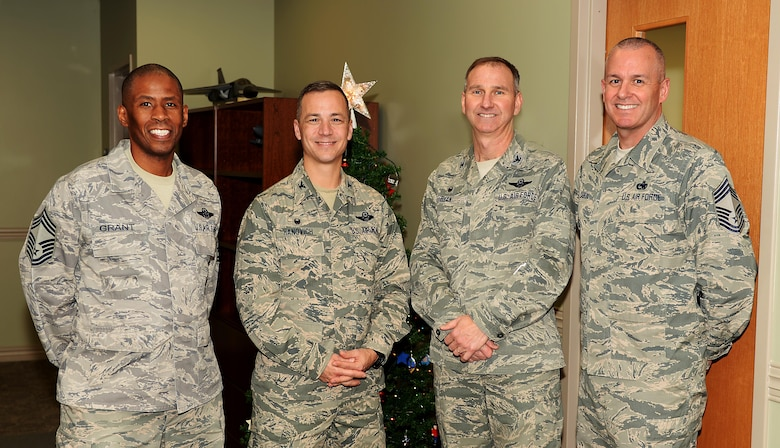 Col. James P. Ryan, the 157th Air Refueling Wing commander, and Col. Robert L. Hanovich, 22nd Operations Group commander, assigned to the 22nd Air Refueling Wing, McConnell Air Force Base, Kan., Chief Master Sgt. Gary A. Cabral, 64th Air Refueling Squadron chief enlisted manager, and Chief Master Sgt. Derrick W. Grant, the 22nd OG boom operator functional manager, pose for a group photo on November 29, 2017, at Pease Air National Guard Base, N.H. The senior leaders met to reinforce the bond between the two Wings as they prepare for the scheduled conversion to the KC-46A Pegasus. (N.H. National Guard photo by Staff Sgt. Kayla Rorick)
