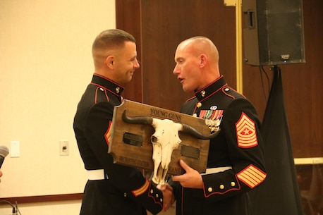 Sergeant Major Christoper Farrell, Sergeant Major, Recruiting Station Kansas City, presents Staff Sgt Larrykeith Conlkin with the Recruiter of the Year award for his efforts during fiscal year 2017. Staff Sgt Conklin contracted more than 30 new Marines as well as conducting more than 100 school visits during the fiscal year.