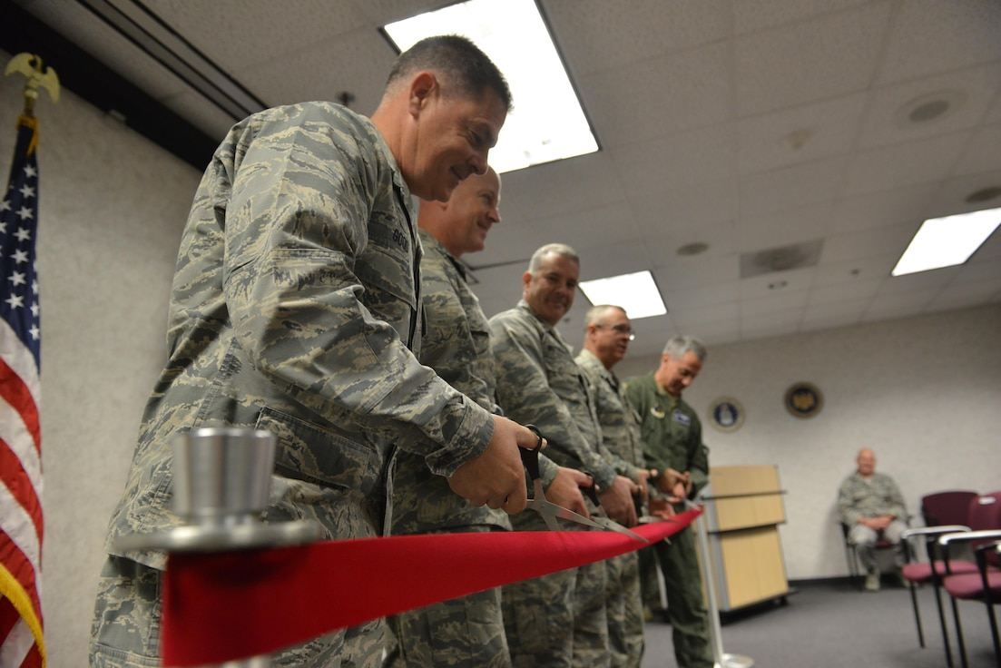 U.S. Air Force leaders within the combat communications community and Georgia Air National Guard cut the ribbon during a ribbon cutting ceremony for the new field training unit at the Savannah Air National Guard Base, Savannah, Ga., Nov. 28, 2017. (U.S. Air National Guard photo by Tech. Sgt. Amber Williams)