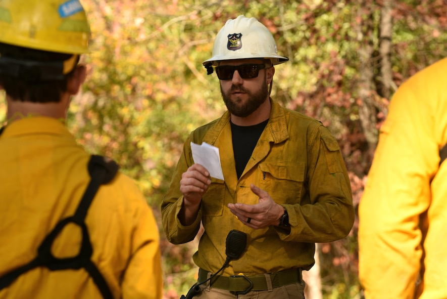 Brock Williams, Shaw Wildland Support Module assistant module leader, speaks to module team members and 20th Civil Engineer Squadron firefighters before a prescribed fire at Poinsett Electronic Combat Range near Wedgefield, South Carolina, Nov. 29, 2017.
