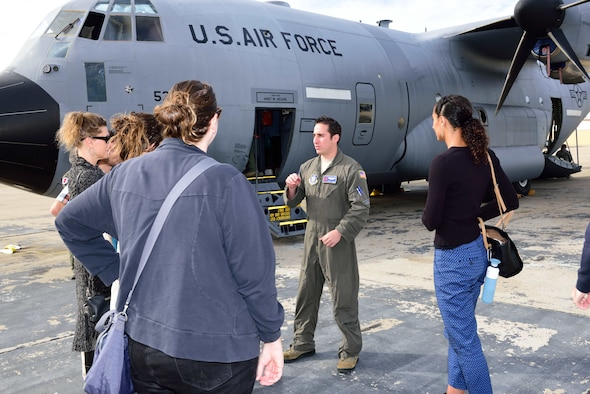 "Maj. John Gharbi, 53rd Weather Reconnaissance Squadron navigator, explains the mission of the 53rd WRS ""Hurricane Hunters"" to students and researchers from the Scripps Institute of Oceanography Nov. 29, 2017, at Brown Field Airport, San Diego, California. Hurricane Hunters met with Scripps scientists that day to discuss plans for participating in atmospheric river reconnaissance missions in early 2018. (U.S. Air Force photo by Tech. Sgt. Ryan Labadens)"