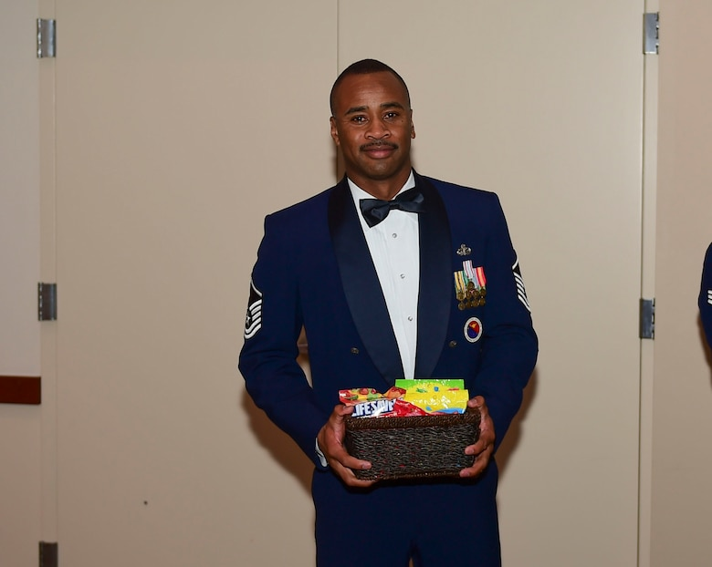 Master Sgt. Imari Motley, 460th Force Support Squadron Airman Leadership School commandant, receives a gift from ALS Class 18-A during their graduation Nov. 29, 2017, on Buckley Air Force Base, Colorado.