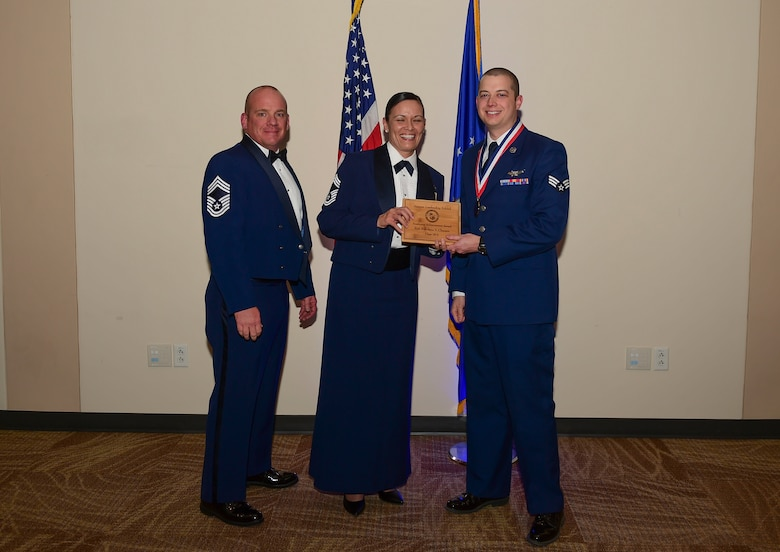 Senior Airman Nikolaus Clausen, 2nd Space Warning Squadron ground system operator, receives the Academic Achievement Award during the Airmen Leadership School Class 18-A graduation Nov. 29, 2017, on Buckley Air Force Base, Colorado.