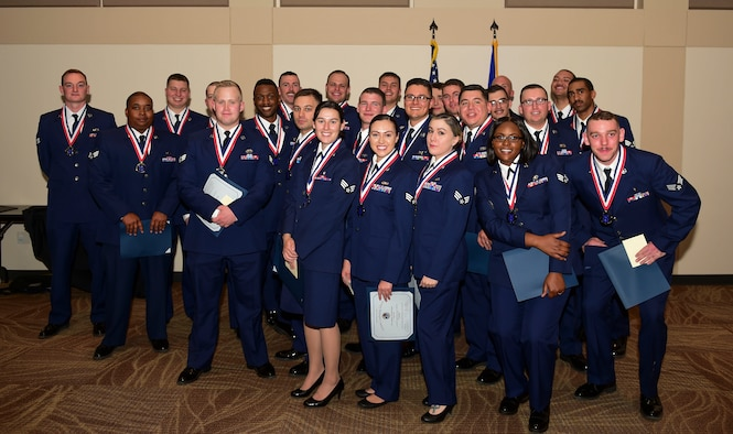 Airman Leadership School class 18-A pose together for the last time during their graduation ceremony Nov. 29, 2017, on Buckley Air Force Base, Colorado.