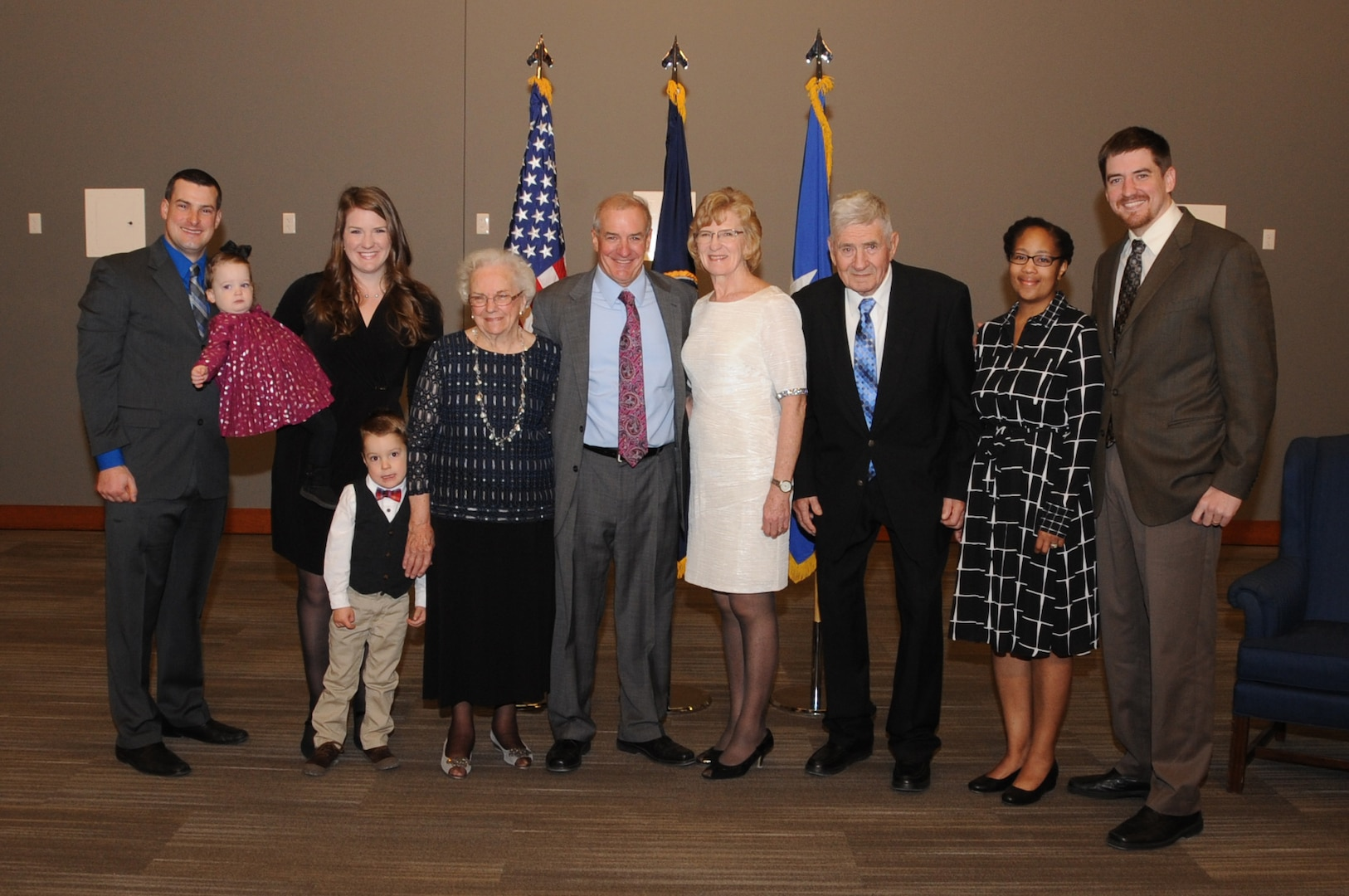 Kenneth Callicutt (center), U.S. Strategic Command (USSTRATCOM) director of capability and resource integration, takes a photo with his family before his retirement ceremony at Offutt Air Force Base, Neb., Dec. 1, 2017. During his 12 years with USSTRATCOM, Callicutt led the team responsible for conducting force management and analysis to include integrating, and advocating future concepts, weapons system development, support for emerging technologies, and command and control architecture. One of nine Department of Defense unified combatant commands, USSTRATCOM has global responsibilities assigned through the Unified Command Plan that include strategic deterrence, nuclear operations, space operations, joint electromagnetic spectrum operations, global strike, missile defense, and analysis and targeting.