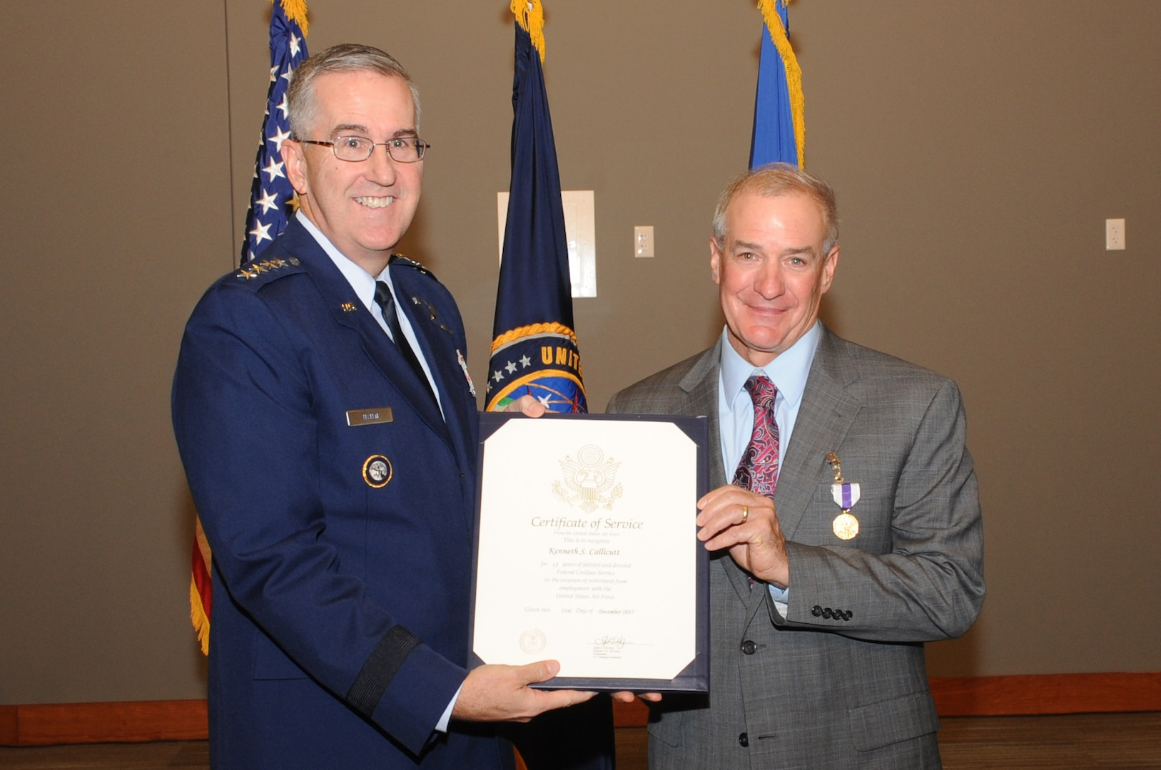 U.S. Air Force Gen. John Hyten, commander of U.S. Strategic Command (USSTRATCOM), presents a certificate of service to Kenneth Callicutt, USSTRATCOM director of capability and resource integration, during his retirement ceremony at Offutt Air Force Base, Neb., Dec. 1, 2017. Callicutt retired after more than 39 years of service as an Air Force officer and member of the Senior Executive Service. During his 12 years with USSTRATCOM, Callicutt led the team responsible for conducting force management and analysis to include integrating, and advocating future concepts, weapons system development, support for emerging technologies, and command and control architecture. One of nine Department of Defense unified combatant commands, USSTRATCOM has global responsibilities assigned through the Unified Command Plan that include strategic deterrence, nuclear operations, space operations, joint electromagnetic spectrum operations, global strike, missile defense, and analysis and targeting.