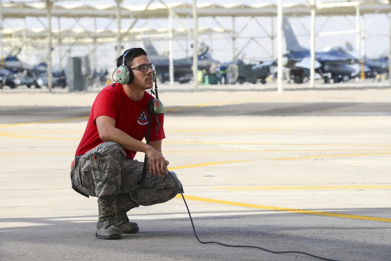 Airman 1st Class Austin Tow, 63rd Aircraft Maintenance Unit crew chief, prepares to marshal an F-35A Lightning II at Luke Air Force Base, Ariz., Dec. 1, 2017. Seven aircraft are currently assigned to the 63rd Fighter Squadron with the number expected to reach 22 in the near future. (U.S. Air Force photo/Airman 1st Class Caleb Worpel)
