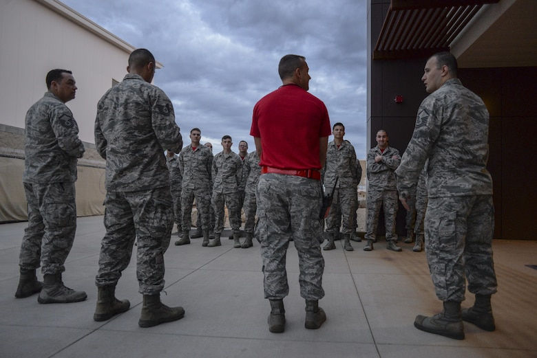 Airmen assigned the 63rd Aircraft Maintenance Unit stand in formation for roll call at Luke Air Force Base, Ariz., Dec. 1, 2017. Currently, 146 personnel are assigned to the unit with the number expected to grow to over 200 in the near future. (U.S. Air Force photo/Airman 1st Class Caleb Worpel)