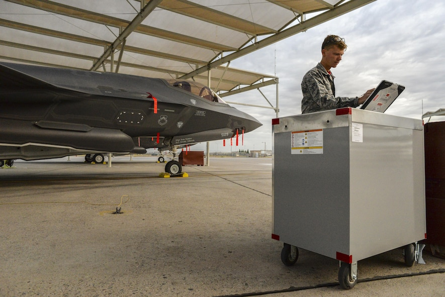 Airman 1st Class Paul Lively, 63rd Aircraft Maintenance Unit crew chief, sets up his work station on the flight line at Luke Air Force Base, Ariz., Dec. 1, 2017. For the past two months, the 63rd AMU has contributed to the success of 162 sorties and 228.3 flying hours in support of the Luke's F-35 program. (U.S. Air Force photo/Airman 1st Class Caleb Worpel)