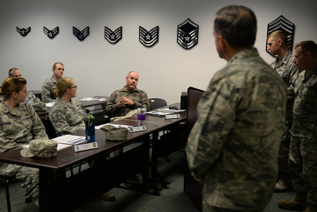 Joseph Halter (middle), 9th Contracting Squadron contract specialist, asks Gen. David L. Goldfein, Chief of Staff of the Air Force, during Goldfein's visit to a Flight Leadership Course, Nov. 30, 2017, at Beale Air Force Base, California. The Flight Leadership Course is designed to educate aspiring leaders on tools and programs available to become effective leaders.(U.S. Air Force photo/ Senior Airman Ramon A. Adelan)