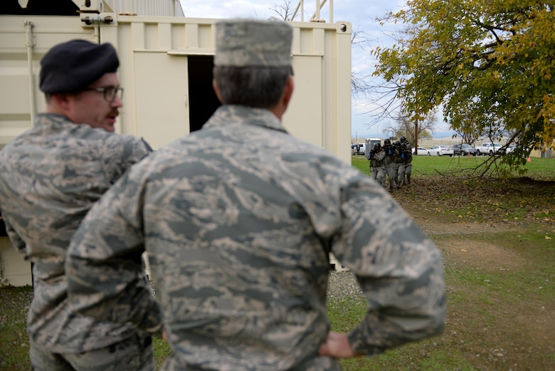 Tech. Sgt. Nicholas Weiss (left), 9th Security Forces Squadron member, explains a demonstration at a newly constructed training area to Gen. David L. Goldfein, Chief of Staff of the Air Force, Nov. 30, 2017, at Beale Air Force Base, California. The training area was designed to incorporate more training scenarios to prepare defenders for deployment and increase readiness.(U.S. Air Force photo/ Senior Airman Ramon A. Adelan)