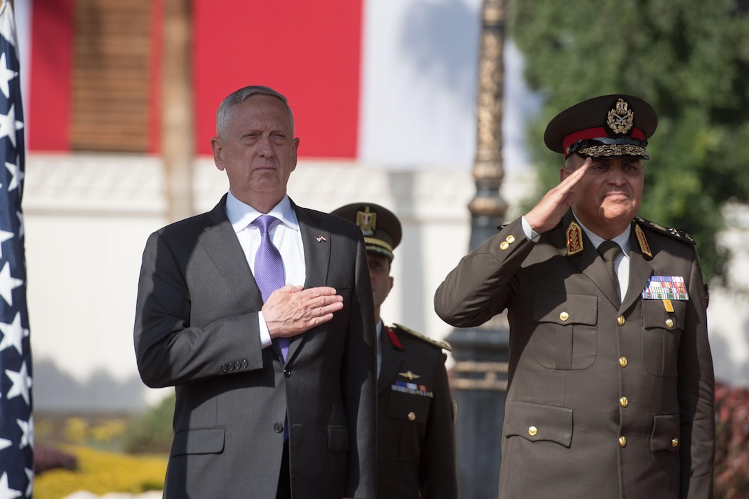 Defense Secretary James N. Mattis and the Egyptian defense minister stand at attention.
