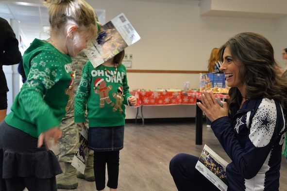 Dallas Cowboys Cheerleader Jinelle Esther, spends time with deployed affected families during a luncheon at the base chapel Dec. 2, 2017, at Malmstrom Air Force Base, Mont.