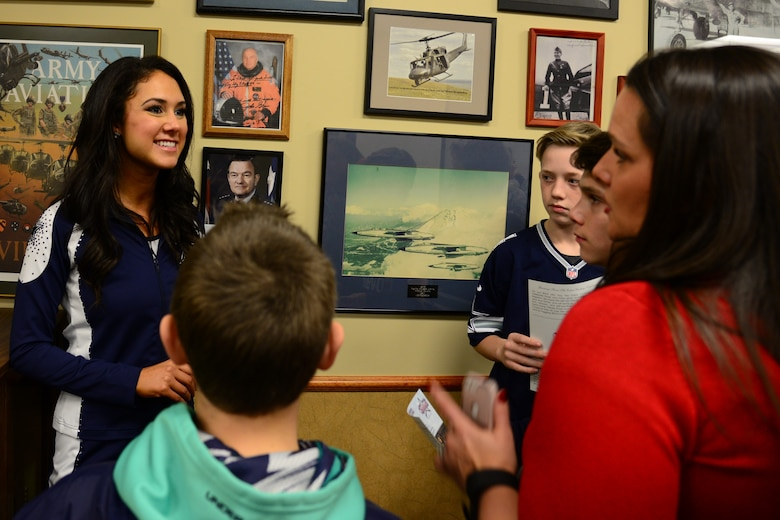 Dallas Cowboys Cheerleader Tess Guidry, speaks to families during a meet and greet Dec. 1, 2017, at Malmstrom Air Force Base, Mont.