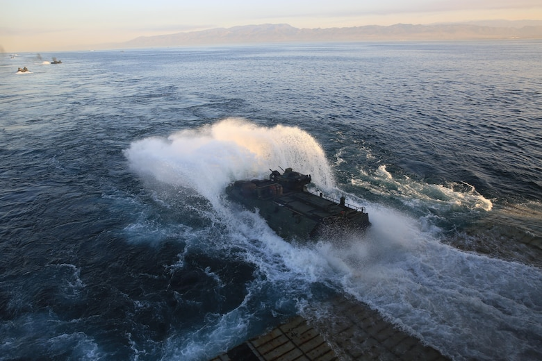U.S. Marines with the 3rd Assault Amphibian Battalion, 1st Marine Division, depart the USS Rushmore to conduct an amphibious assault on Red Beach, Camp Pendleton, California, during Exercise Dawn Blitz, Oct. 27, 2017. DB17 is a scenario-driven amphibious exercise conducted between Expeditionary Strike Group 3 and 1st Marine Expeditionary Brigade, testing their ability to conduct amphibious operations in response to global crises and to project power ashore as part of a Navy-Marine Corps team.