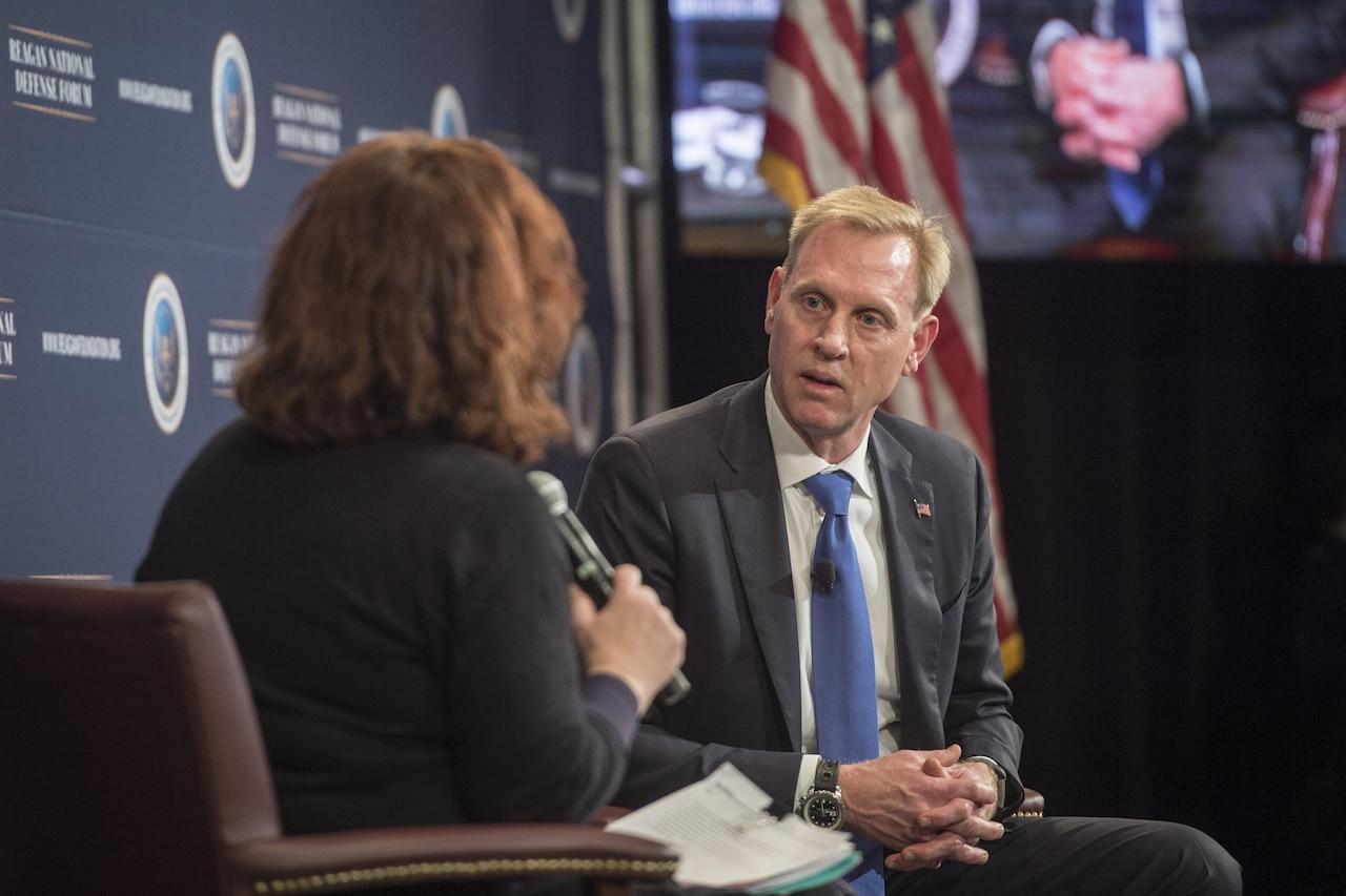 Deputy Defense Secretary Patrick M. Shanahan speaks with a reporter.